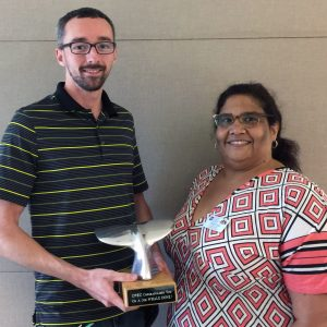 Darin McClain, left, received the Whale Done Award from Chenita Hart.